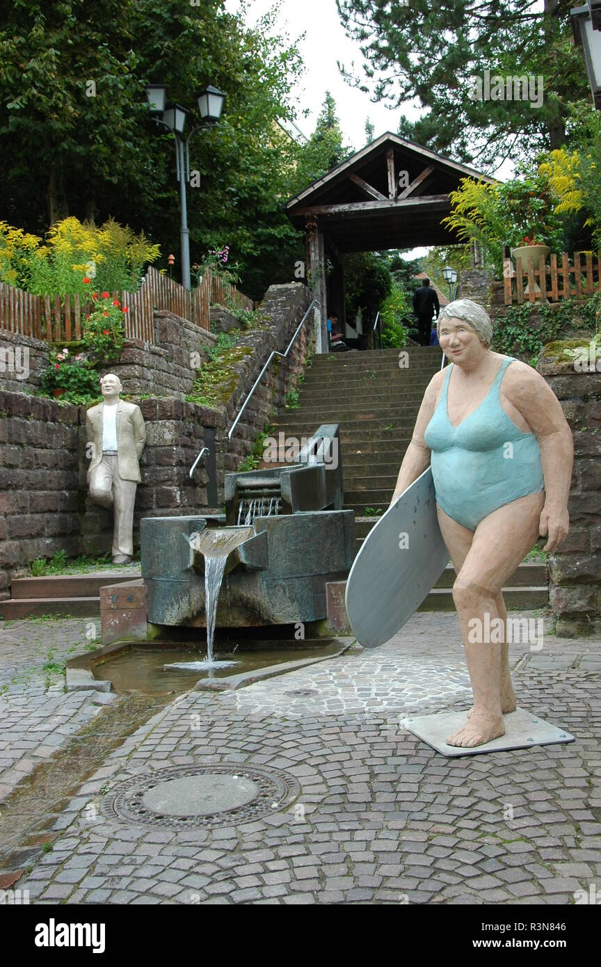 woman with surfboard at the candelabrun in mosbach Stock Photo