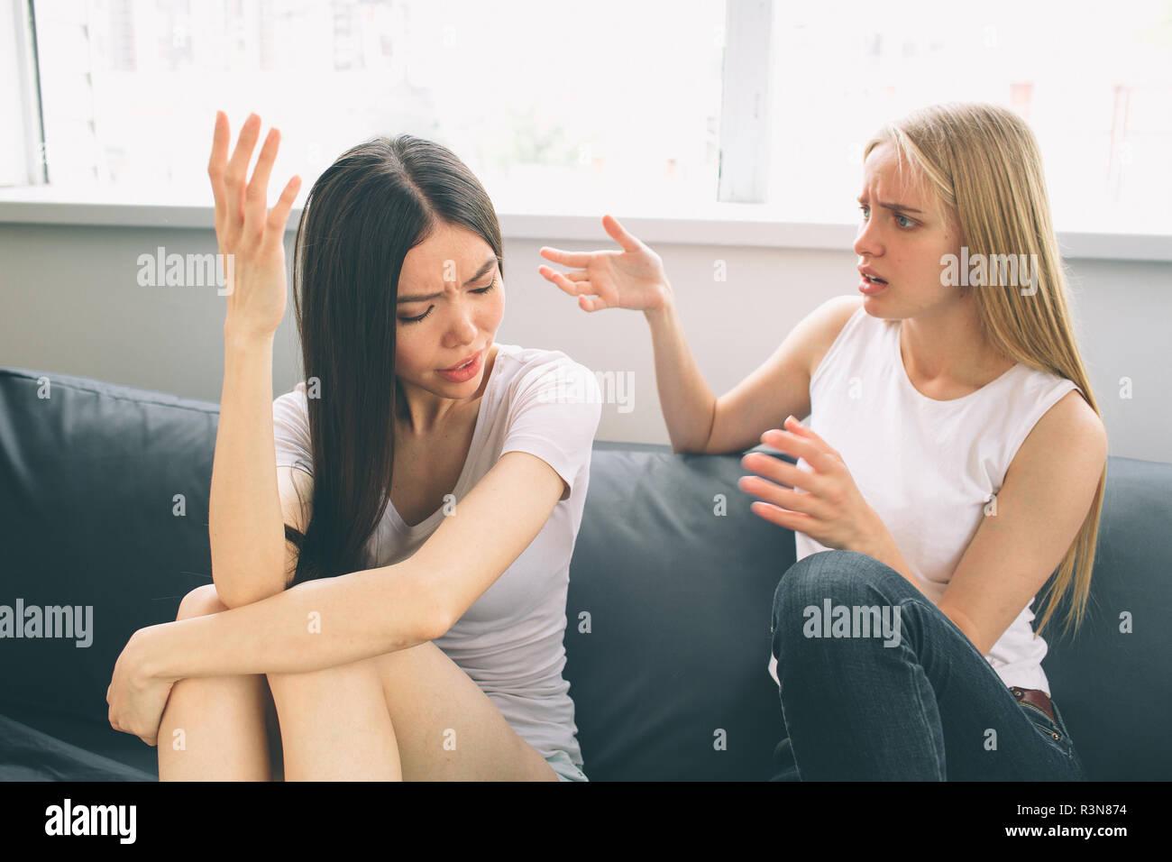 girls quarrel. Women talking loudly about something - Stock Image