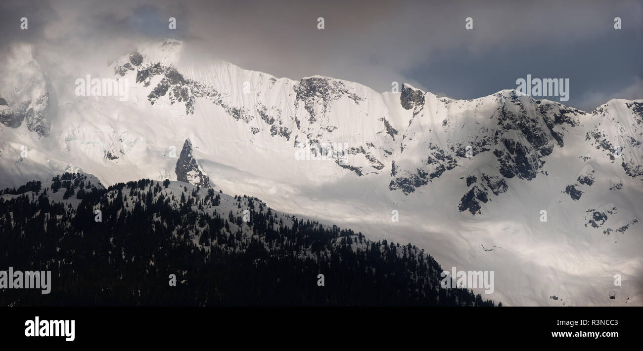 Canada, British Columbia. Snow-covered mountain range. - Stock Image