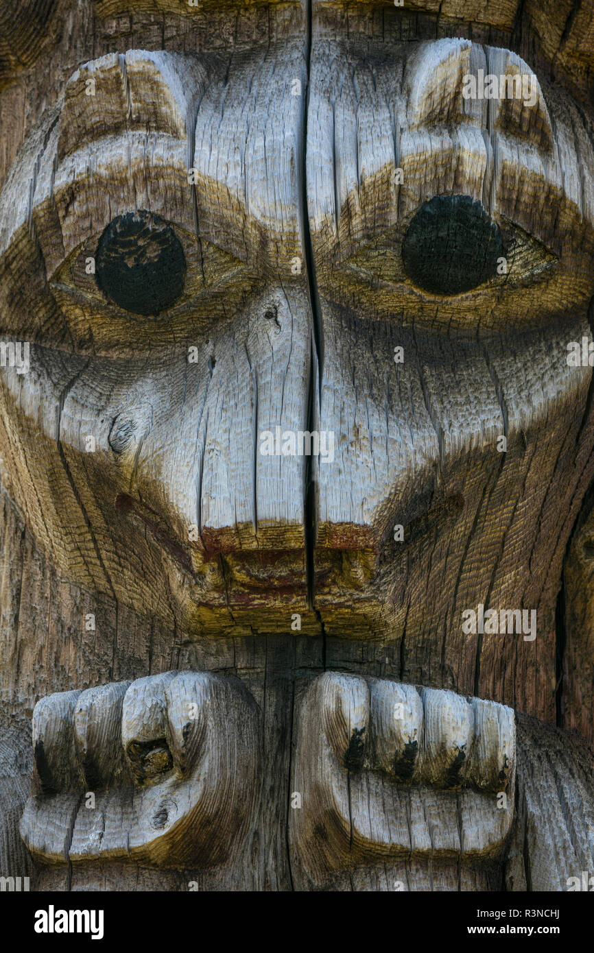 Canada, British Columbia, Gitanyow. Detail of Gitxsan tribe totem pole. - Stock Image