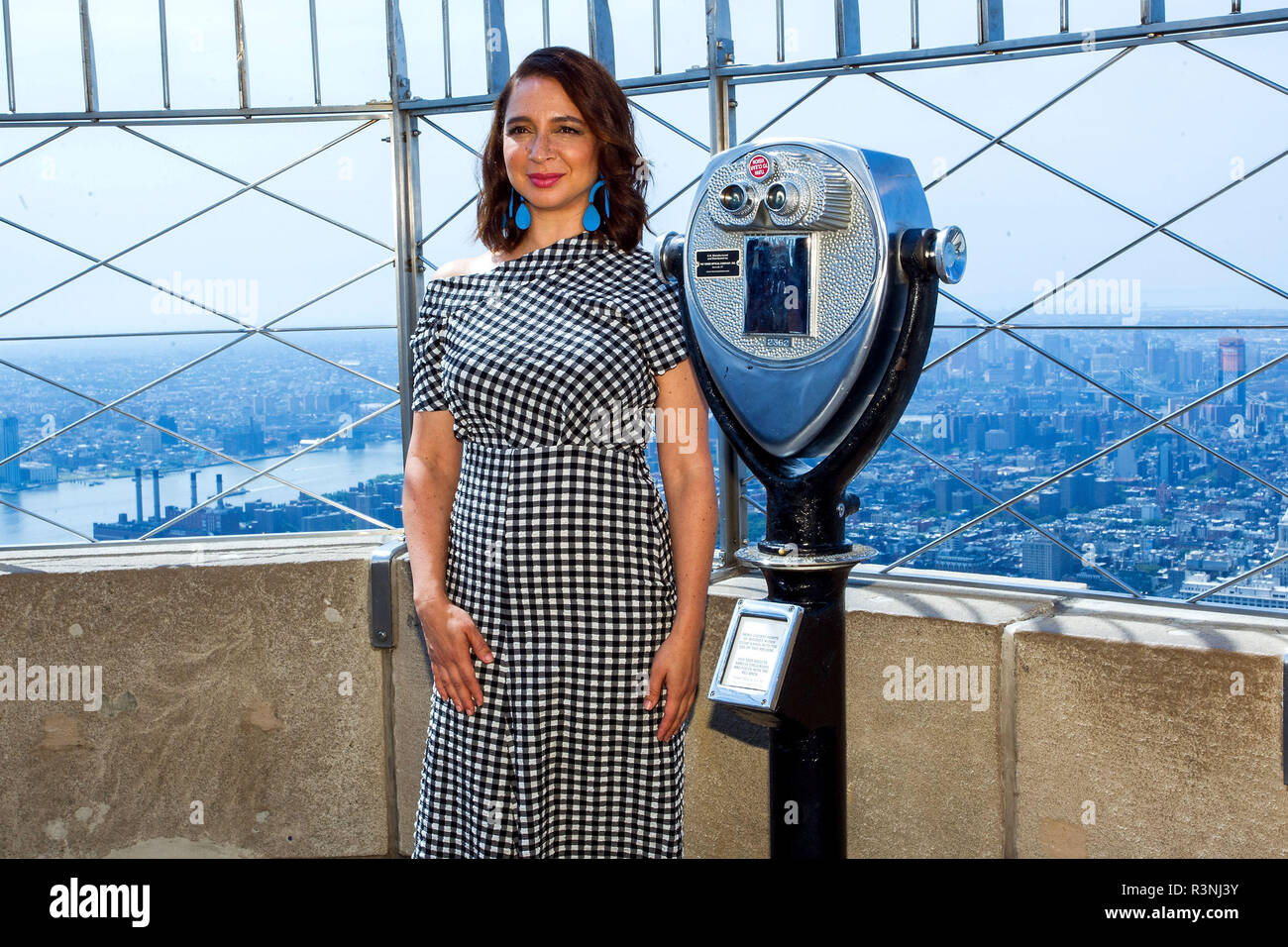 NEW YORK, NY - JULY 17:  Actress Maya Rudolph of the film 'The Emoji Movie' poses for a photo to celebrate World Emoji Day at The Empire State Building on July 17, 2017 in New York City.  (Photo by Steve Mack/S.D. Mack Pictures) - Stock Image