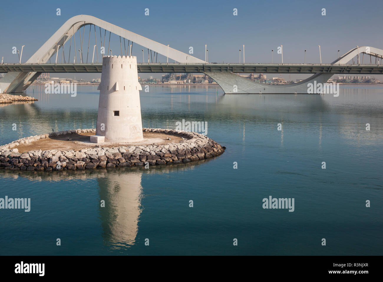 UAE, Abu Dhabi. Sheikh Zayed Bridge, designed by Zaha Hadid and old Al Maqta Fort watchtower Stock Photo