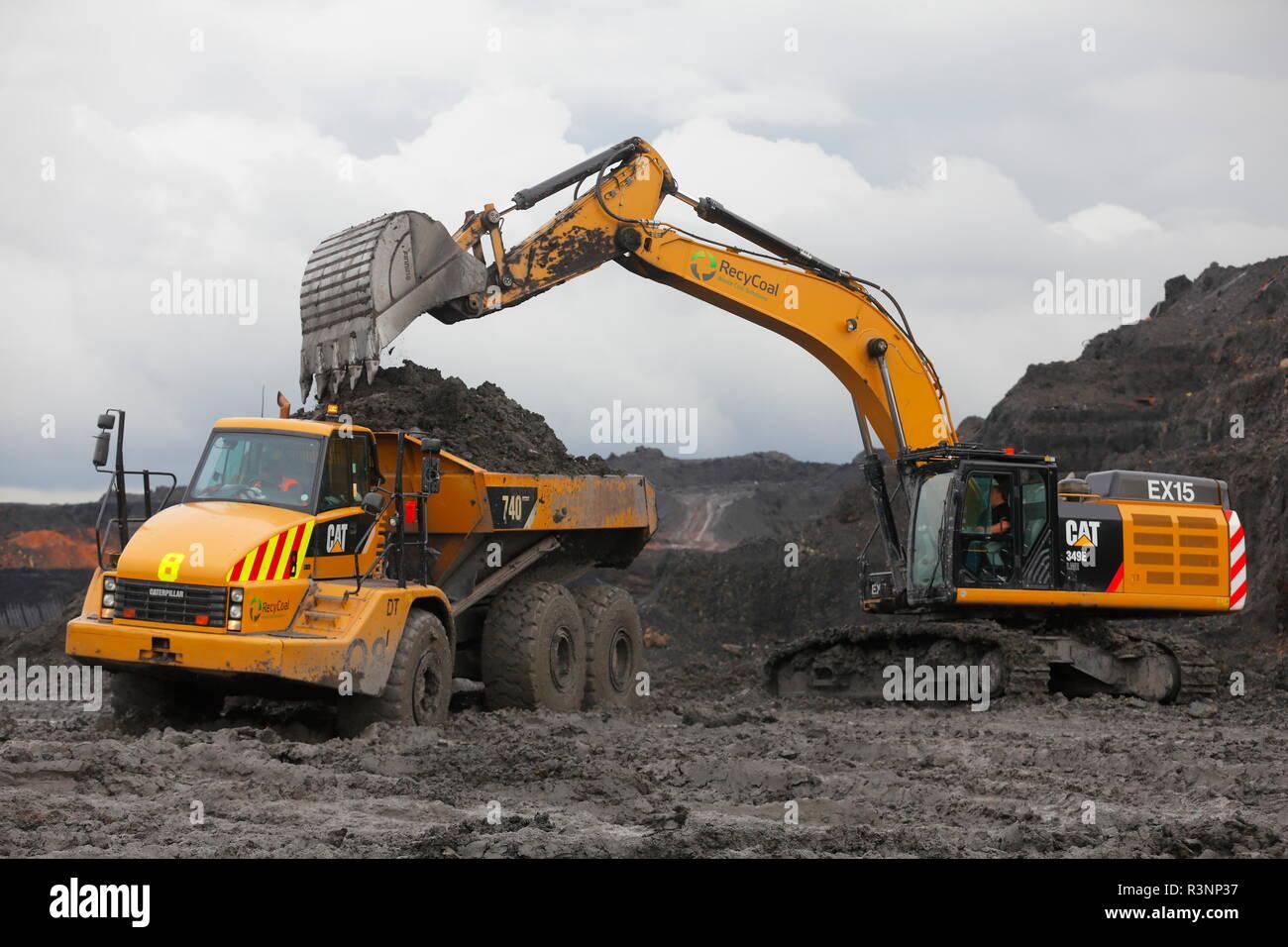 A Caterpillar 349E loading dump trucks on the Recycoal,Coal