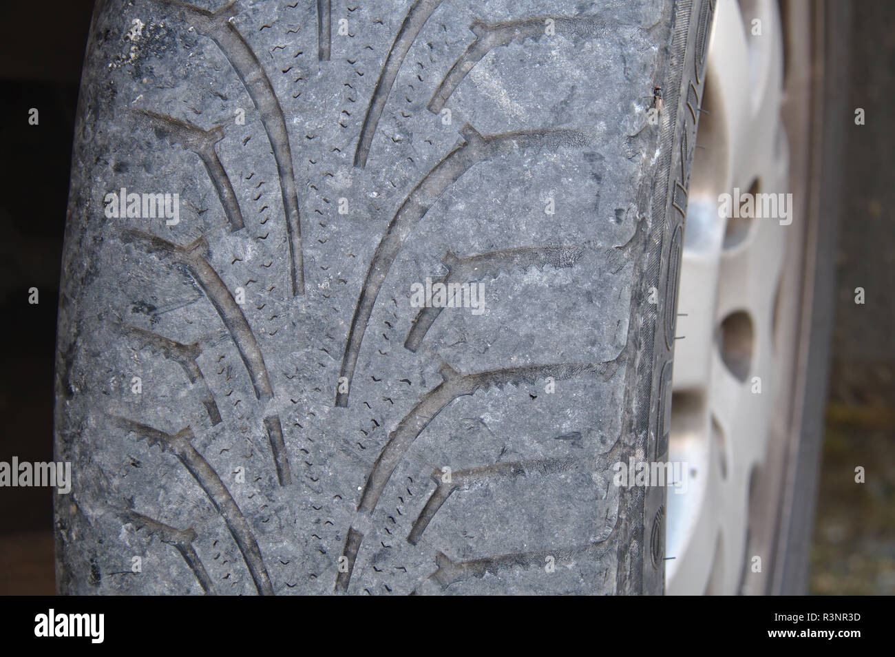 Worn out winter tire of a car. - Stock Image