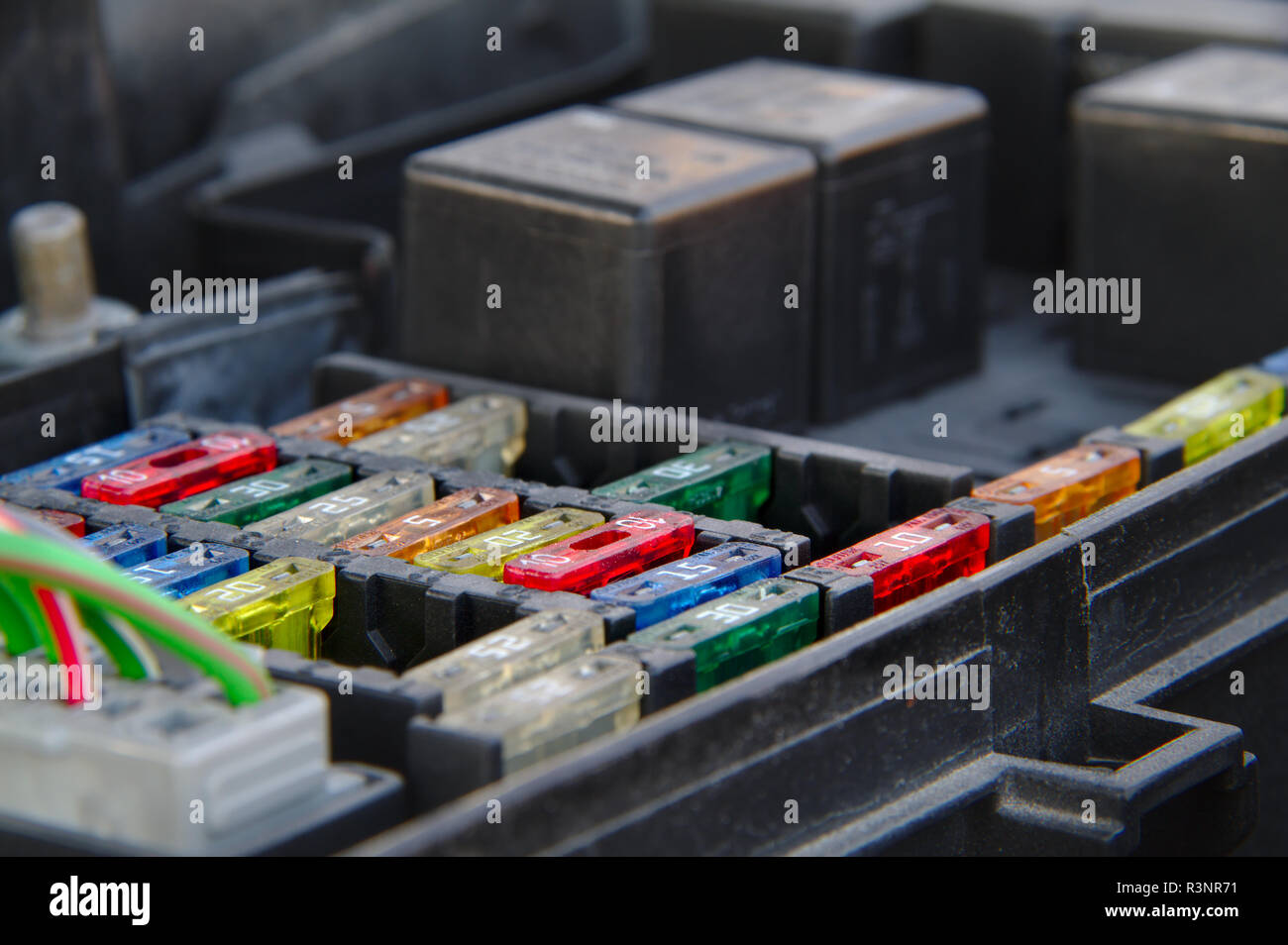 Under hood fusebox of a car with relays. - Stock Image