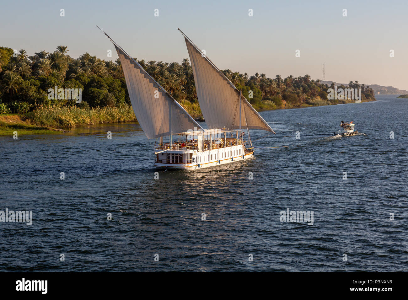 People on board a bespoke Dahabiya sailboat called MS Donia Dahabiya, a Cruise boat on the River Nile, Egypt, Africa - Stock Image