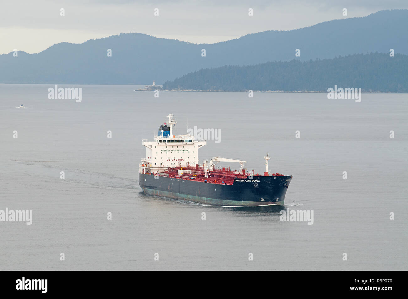 The USA registered oil/chemical tanker passes Prospect point as it slowly makes its way into Vancouver in British Columbia Canada. - Stock Image