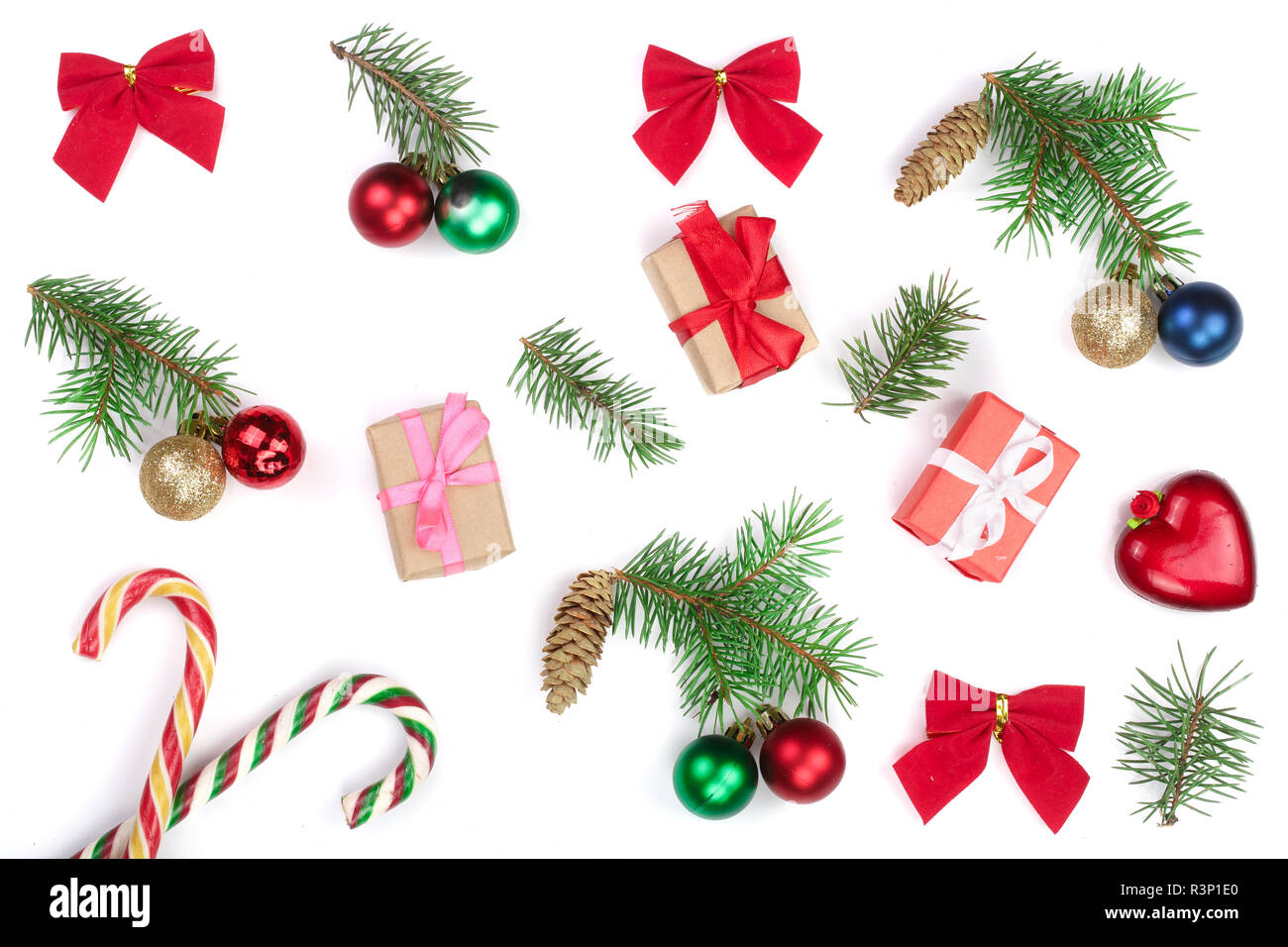 Christmas background with fir branches and decoration isolated on white background. Top view. Flat lay - Stock Image