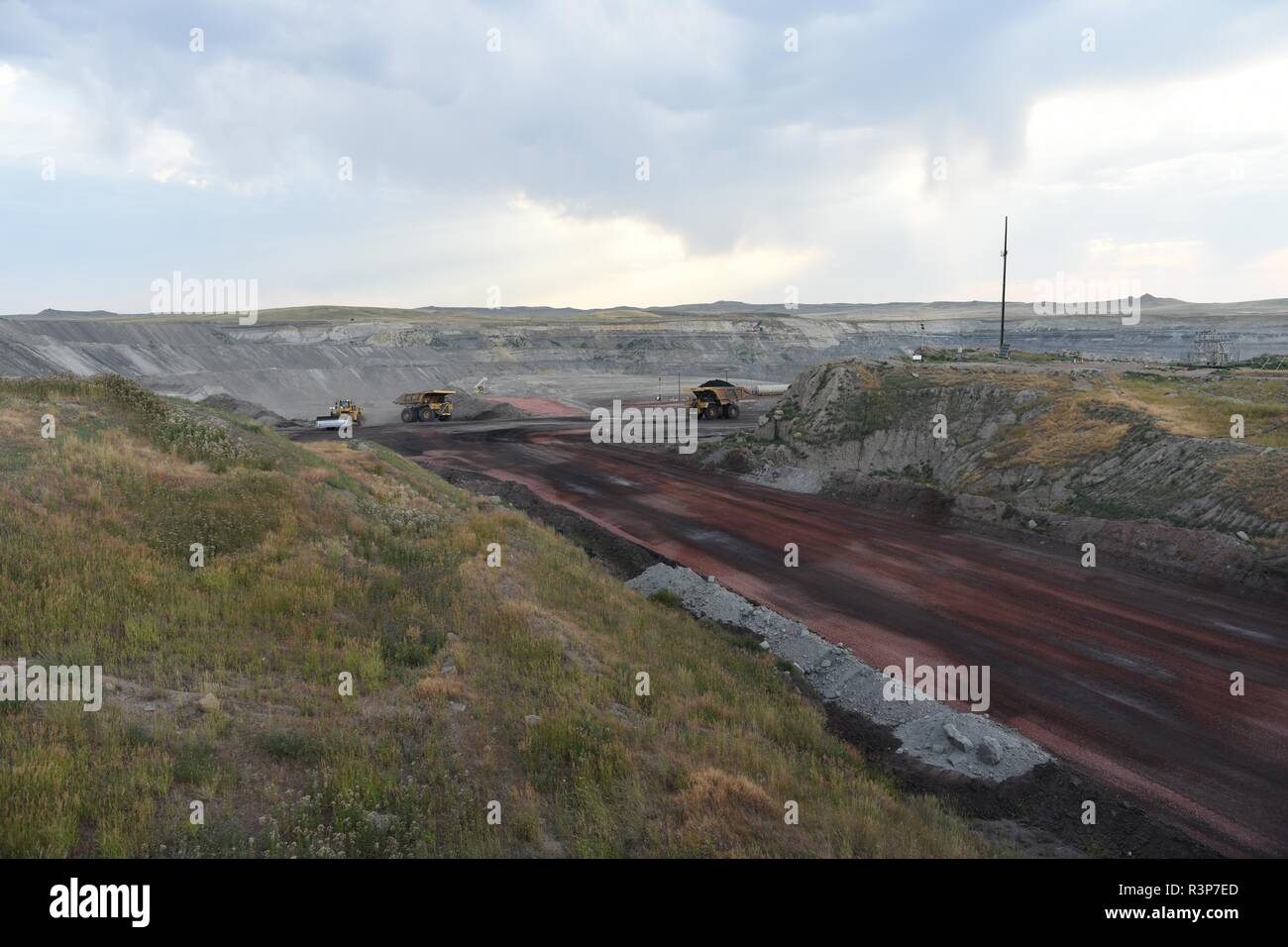 A large coal mining truck transports coal inside an open pit coal mine in the Powder River Basin of Wyoming, USA. Stock Photo