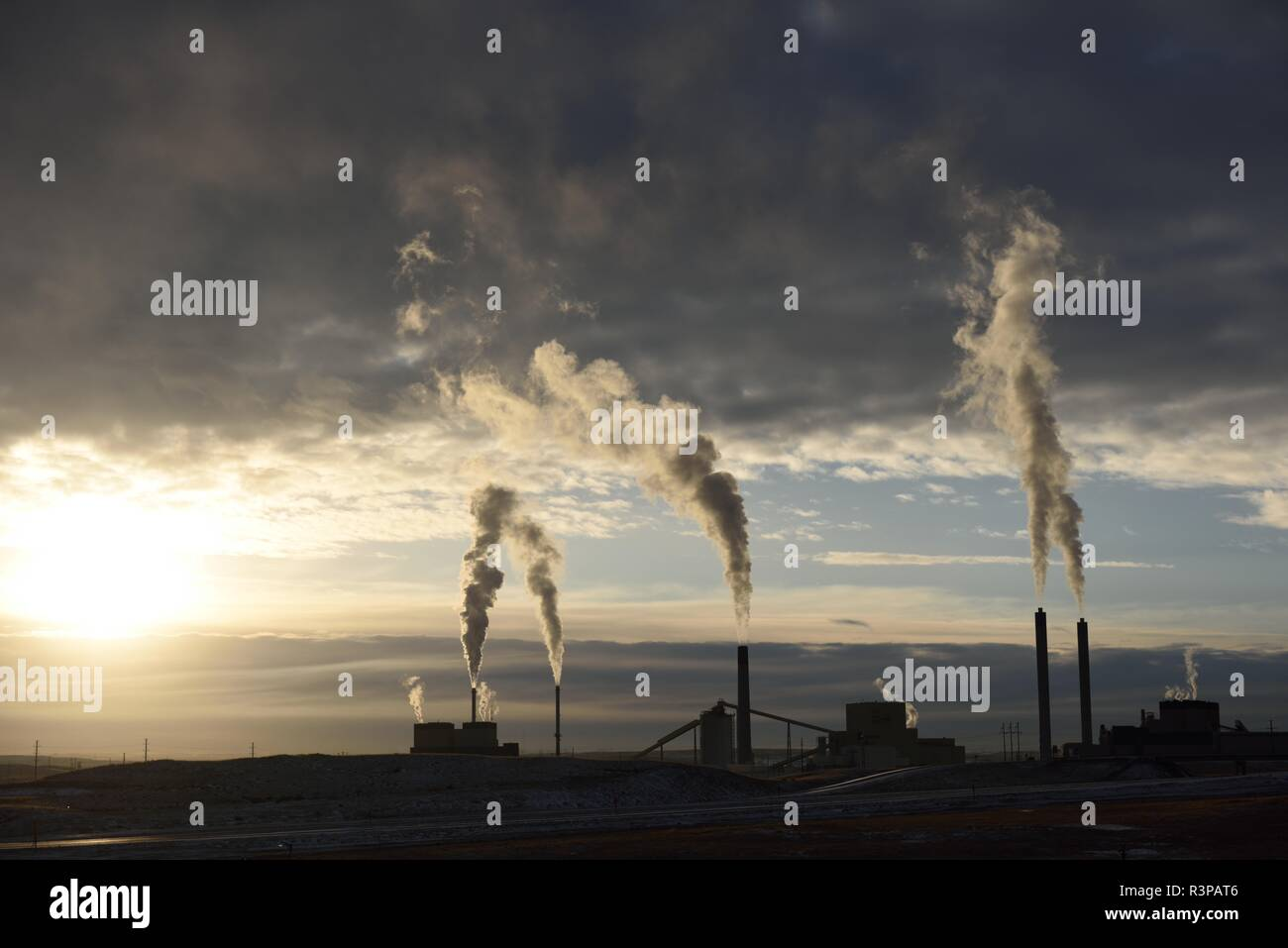 Silhouette of smoke stack emissions rising from a coal-fired power plant near Gillette, Wyoming / USA. - Stock Image