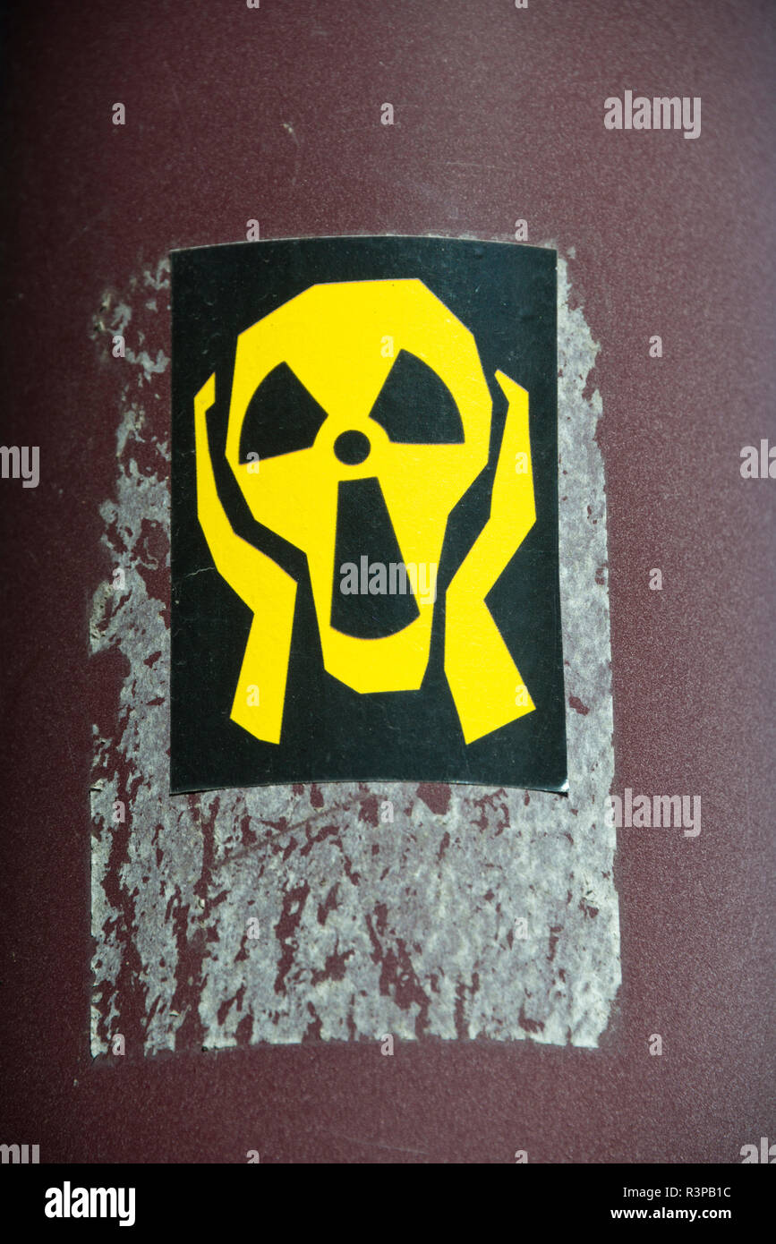 France, Alsace, Colmar. A street poster of the international radiation symbol (also known as the trefoil) shaped into a screaming skull. Stock Photo