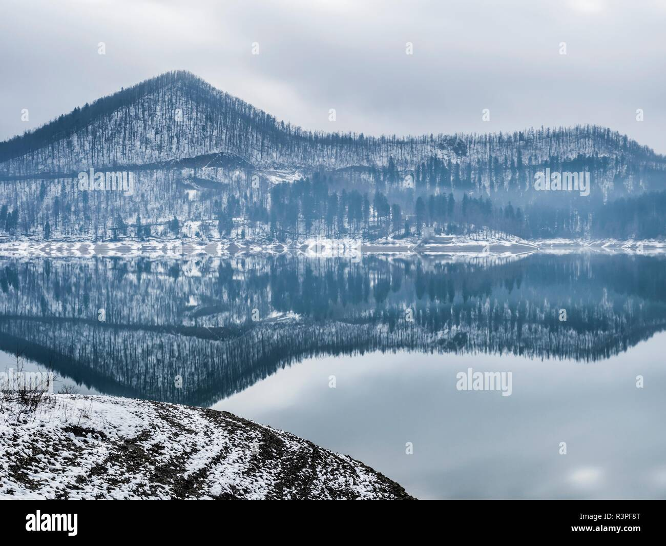 Long exposure early Winter snow in Europe Croatia Lokve lake destination Stock Photo