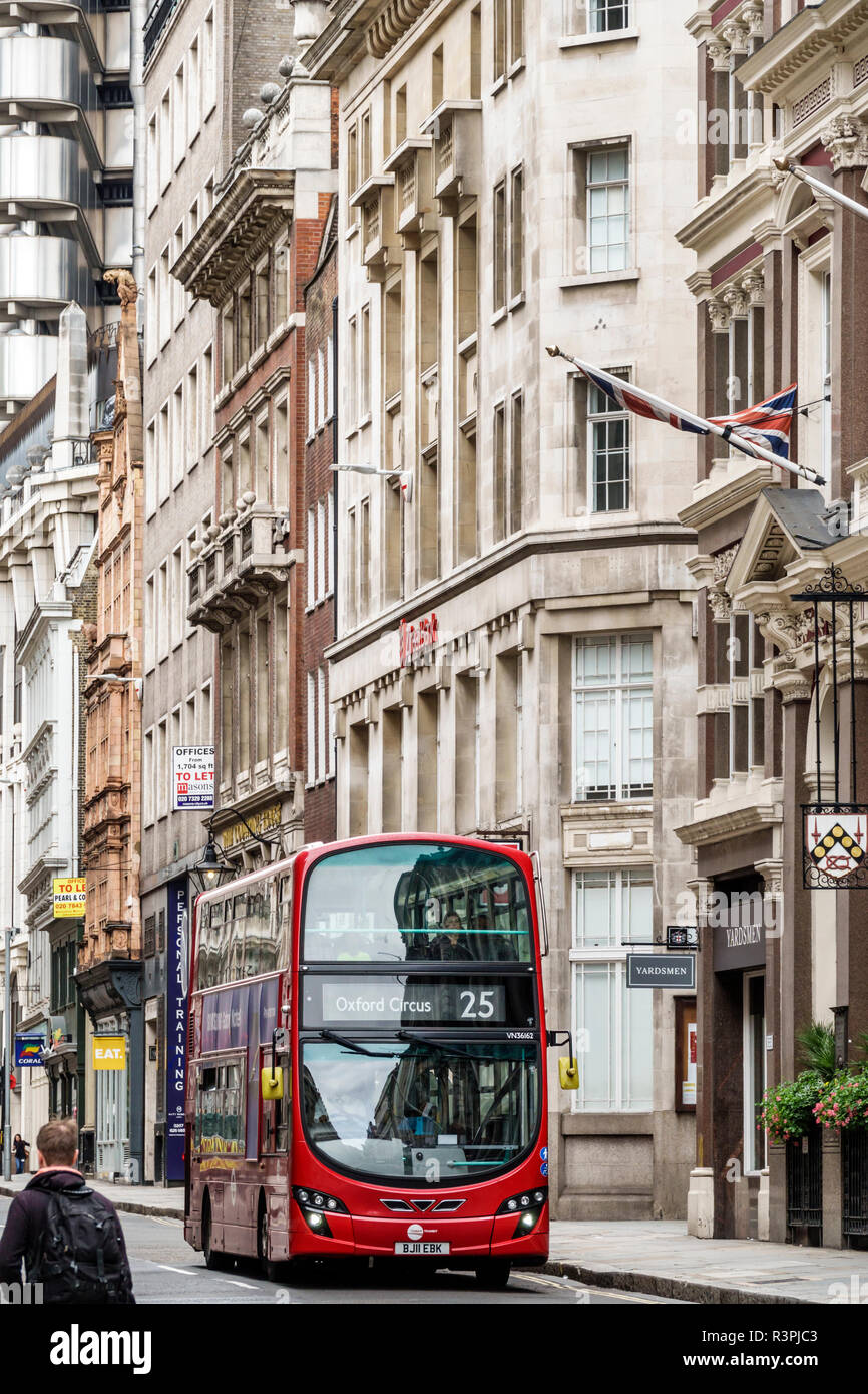 London England Great Britain United Kingdom City of London financial centre center Cornhill office commercial buildings red double-decker bus man pede - Stock Image