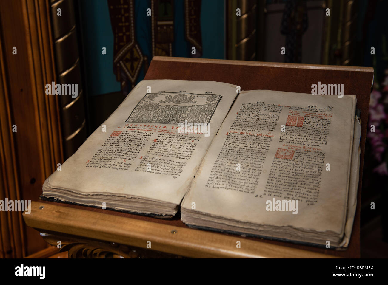 Old Christian manuscript written in Cyrillic on church pulpit. - Stock Image
