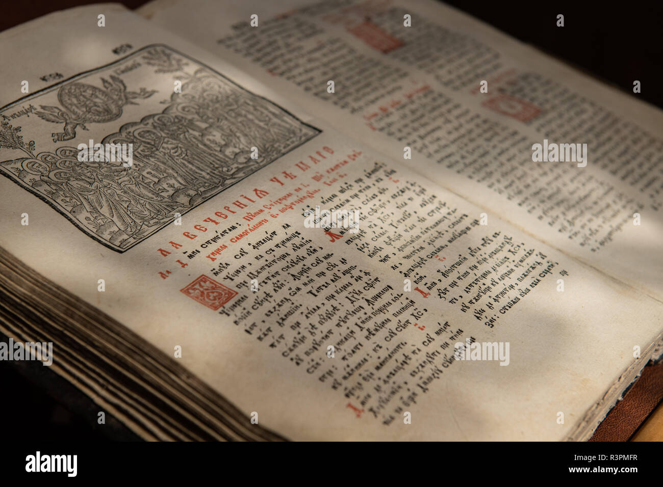 Close up of old Christian manuscript written in Cyrillic on church pulpit. - Stock Image
