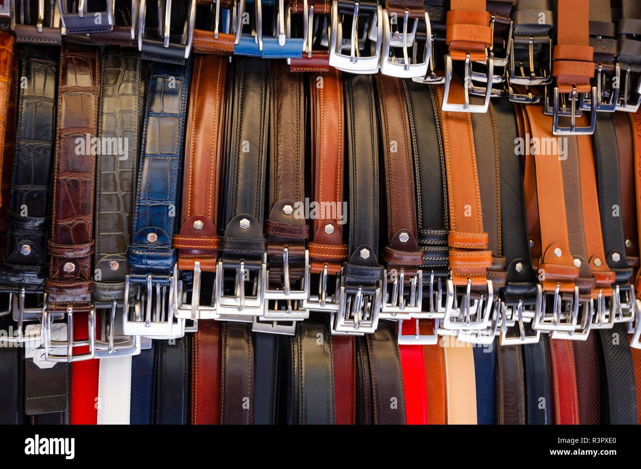 Italian leather belts for sale at Loggia del Mercato Nuovo, Florence, Tuscany, Italy - Stock Image