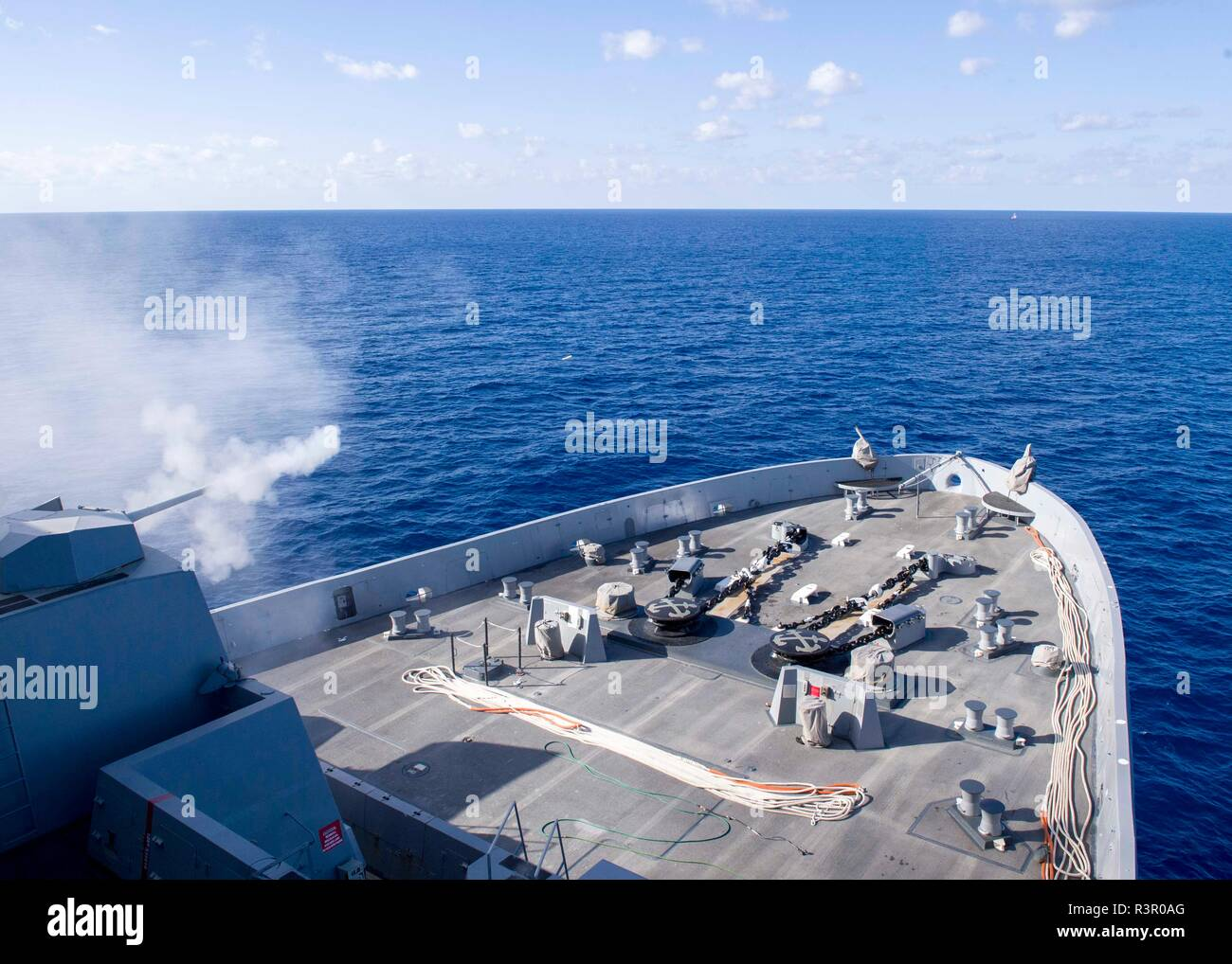 181109-N-PH222-1125 MEDITERRANEAN SEA (Nov. 9, 2018) The San Antonio-class amphibious transport dock ship USS Anchorage (LPD 23) fires its Mark 46-30mm gun during a live-fire exercise in the Mediterranean Sea, Nov. 9, 2018. Anchorage and embarked 13th Marine Expeditionary Unit are deployed to the U.S. 6th Fleet area of operations as a crisis response force in support of regional partners as well as to promote U.S. national security interests in Europe and Africa. (U.S. Navy photo by Mass Communication Specialist 3rd Class Ryan M. Breeden/Released) - Stock Image