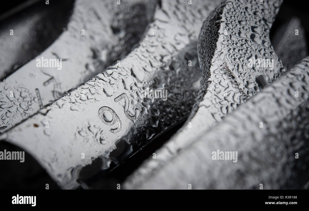 Spanners with overnight dew - Stock Image