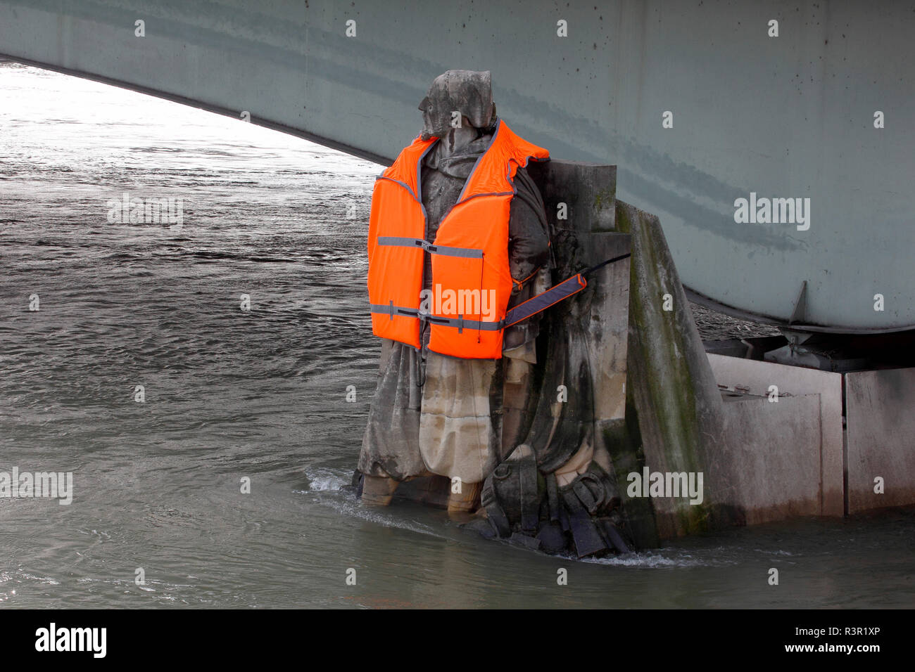 Photographer Yann Arthus-Bertrand dressed the zouave of the Alma bridge with a lifejacket to wake up the consciousness of global warming during the flood of the Seine in Paris in February 2018, France - Stock Image