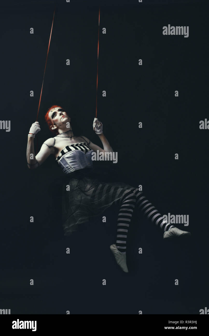 Young woman wearing makeup in dark doll - Stock Image