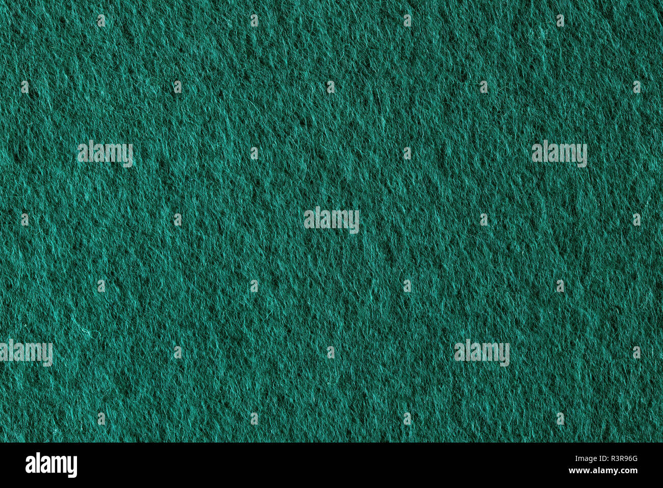 Poker table felt background in green color. - Stock Image