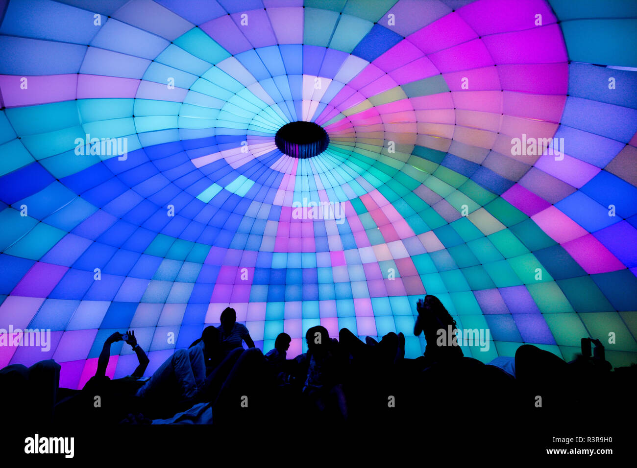 Plume, by Ian Brill, is an immersive, interactive dome of synchronized light and sound gestures. The installation uses motion, sound and color. - Stock Image
