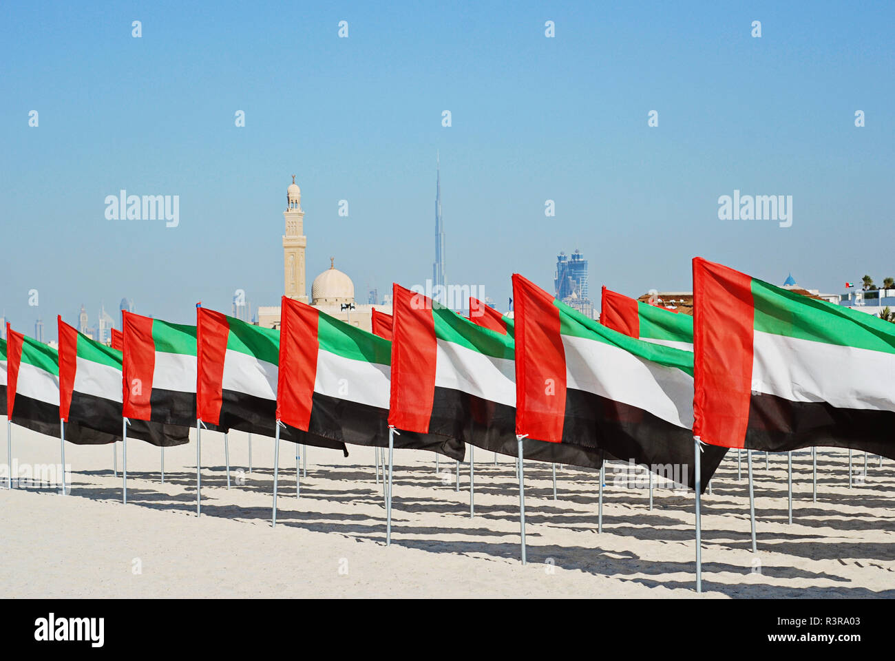 General Dubai city skyline view and lot of United Arab Emirates flags. National Day of the United Arab Emirates Stock Photo