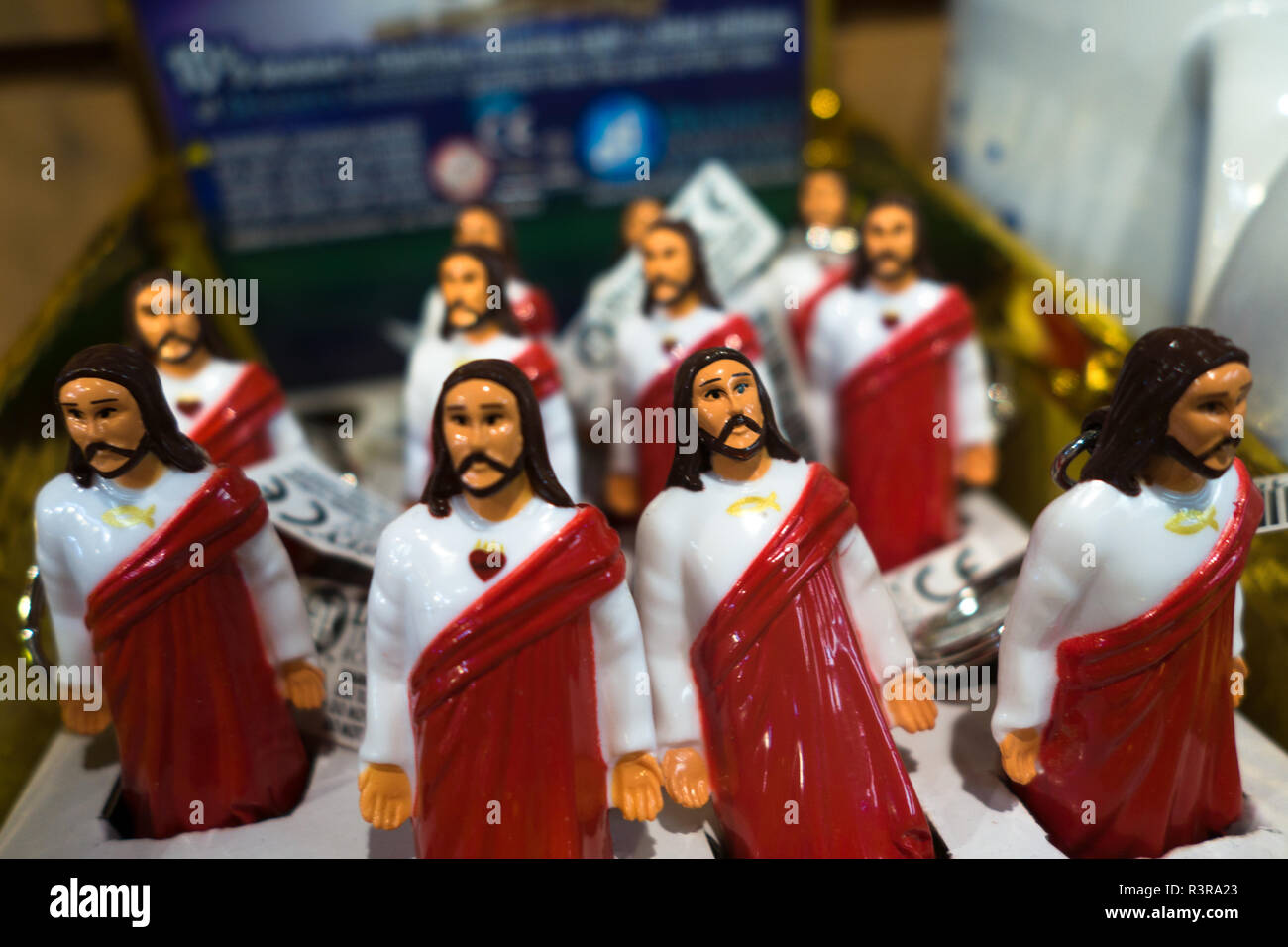 A collection of 'Buddy Christ' figurines for sale in a store.  Buddy Christ is a parody religious icon in the film Dogma. - Stock Image