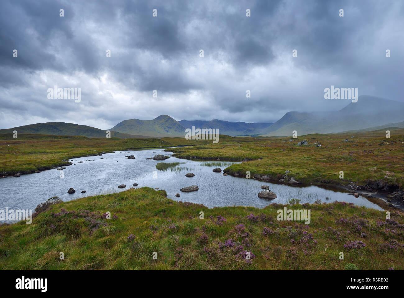 Great Britain, Scotland, Scottish Highlands, Glencoe, Rannoch Moor, Loch Ba and rain clouds - Stock Image