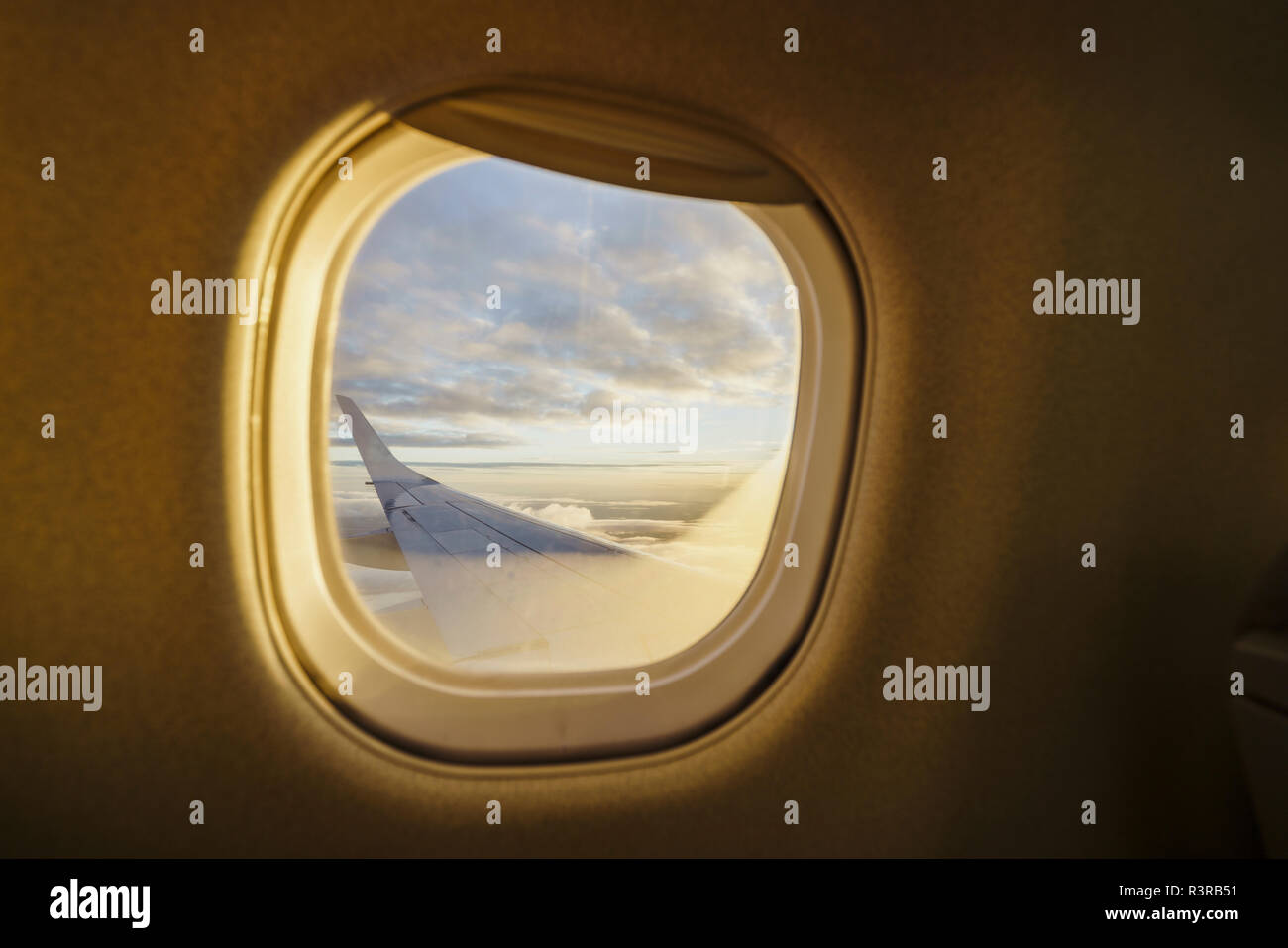 View out of window on wing of a plane Stock Photo
