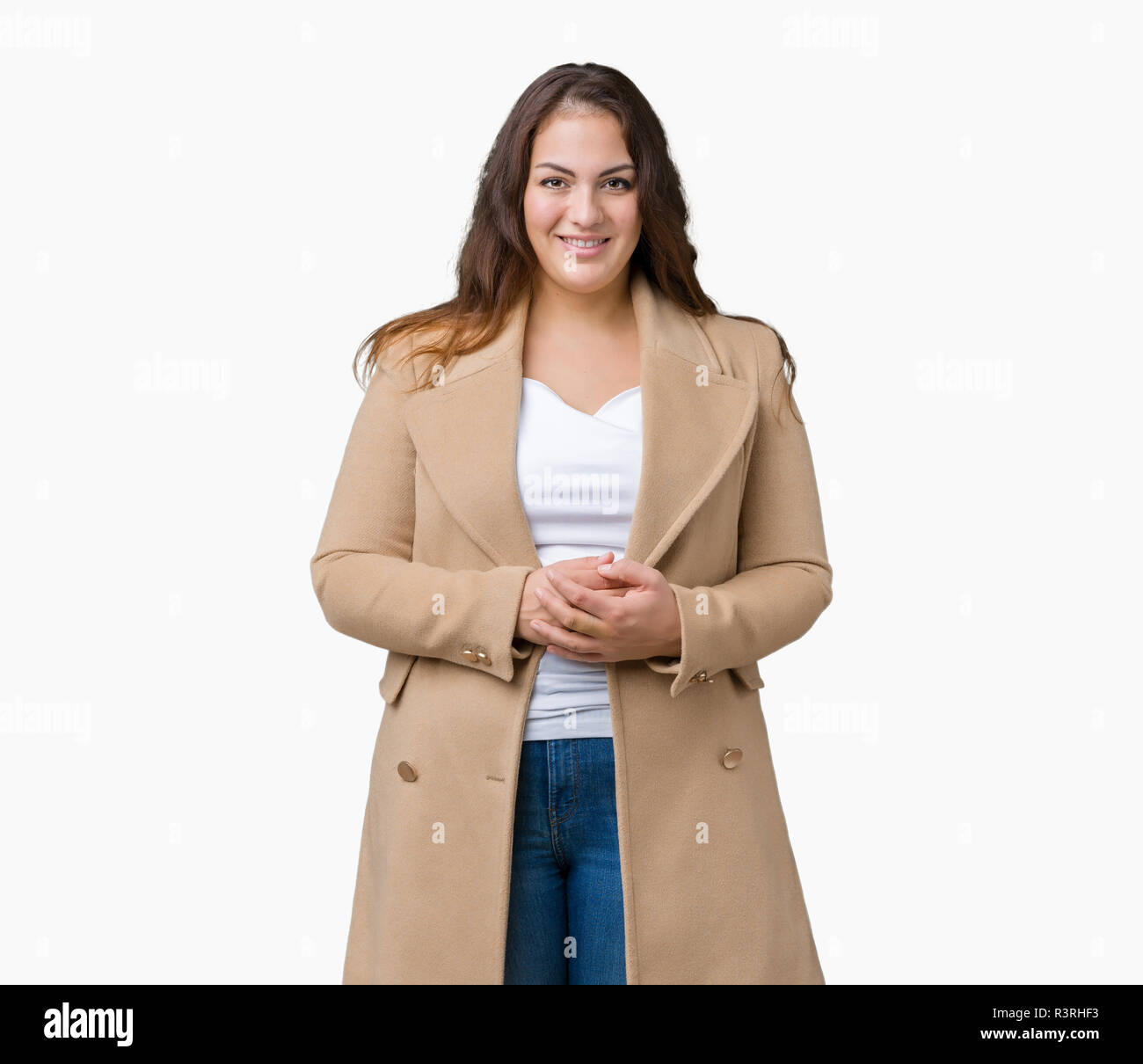 f05fc9c1eab80 Beautiful plus size young woman wearing winter coat over isolated  background Hands together and fingers crossed