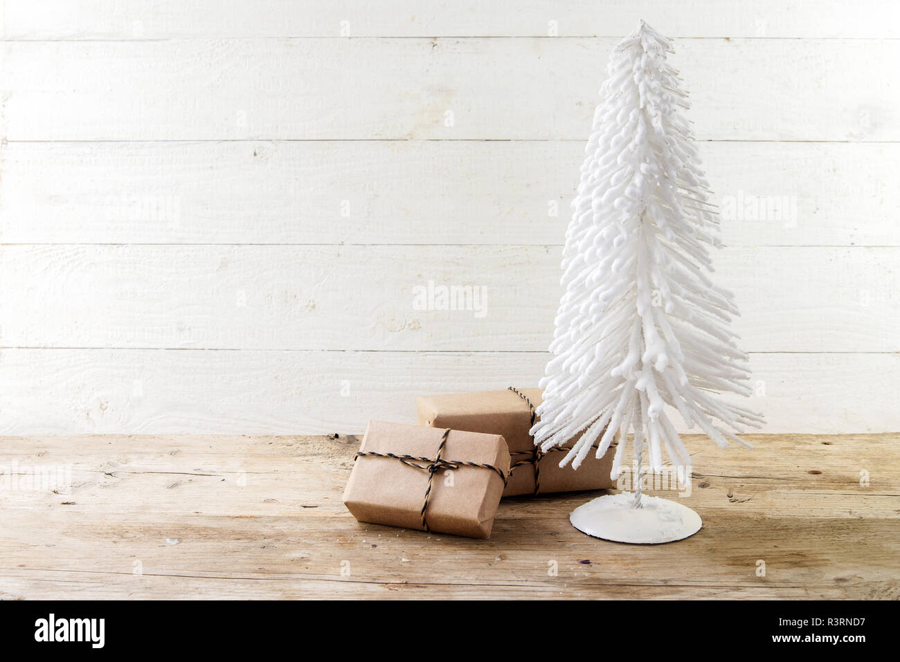 Small Christmas Tree From White Flocked Wire And Gifts In Kraft