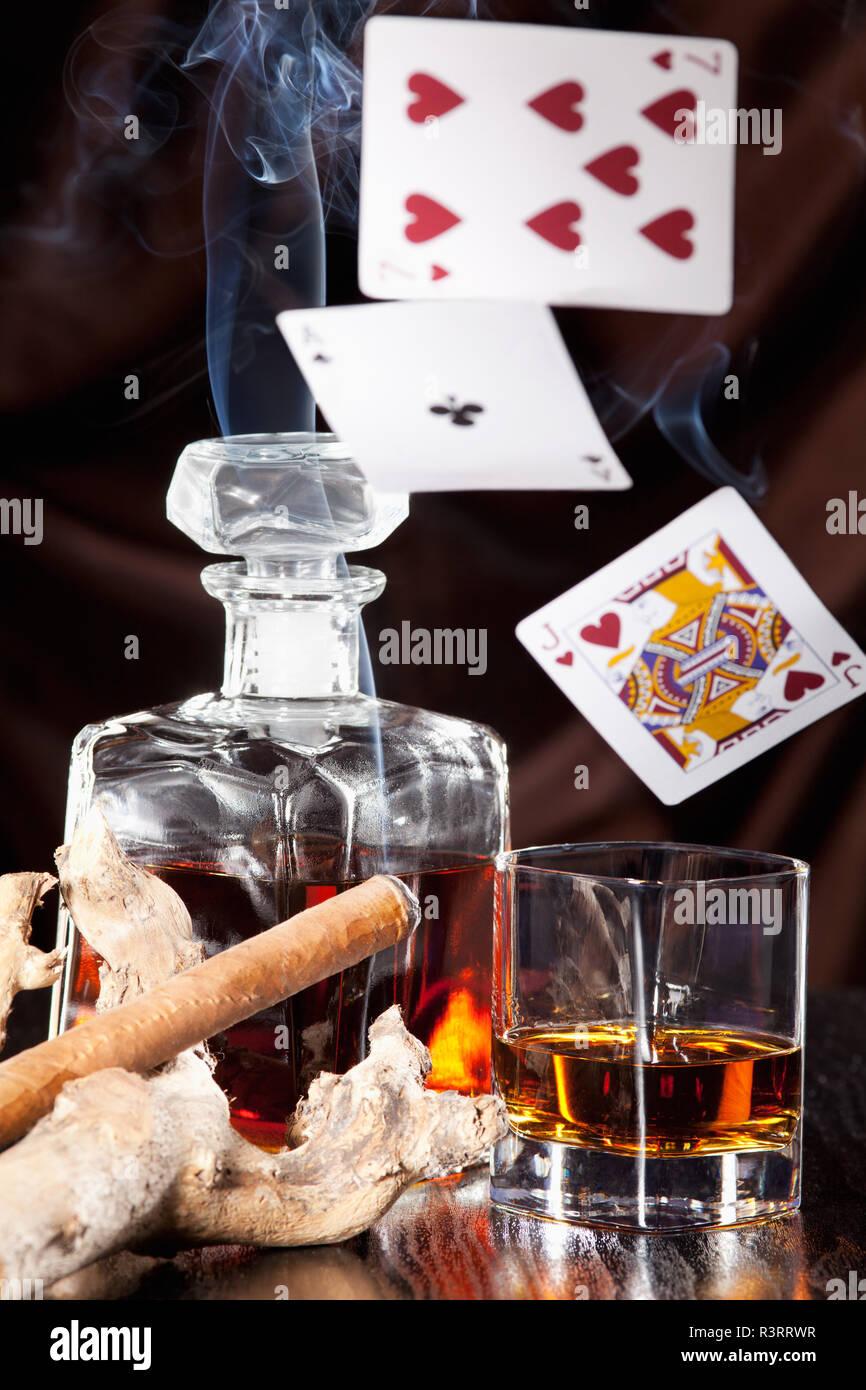 alcohol consumption,gambling and cigar smoke - Stock Image