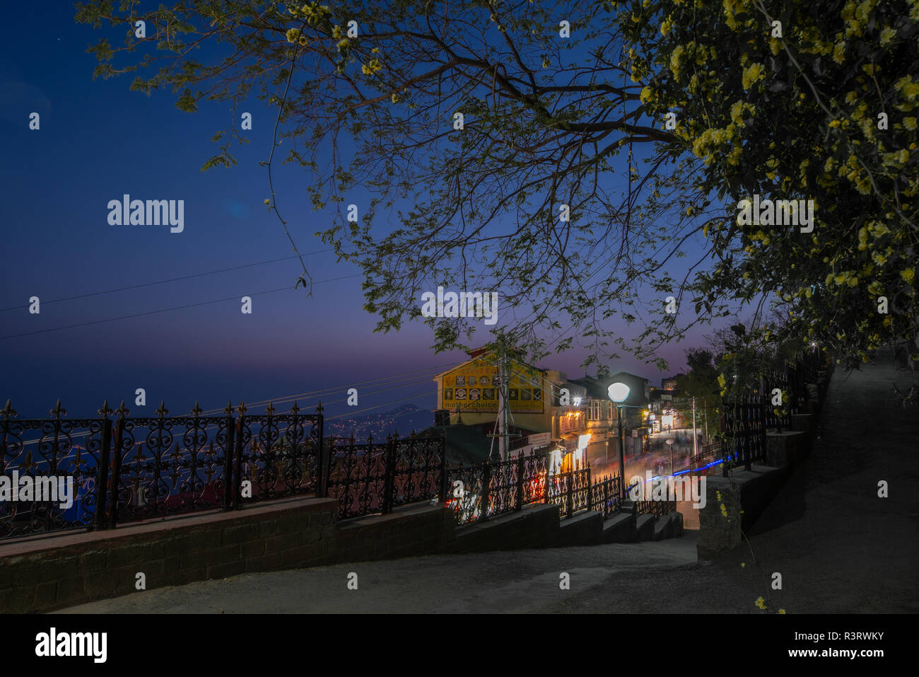 Shimla by night. View from the linking road between the Ridge and the Mall Road. Simla, Himachal Pradesh, India - Stock Image