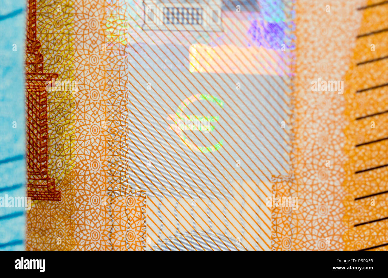 Close-up of the euro symbol on the hologram a new fifty euro banknote. - Stock Image