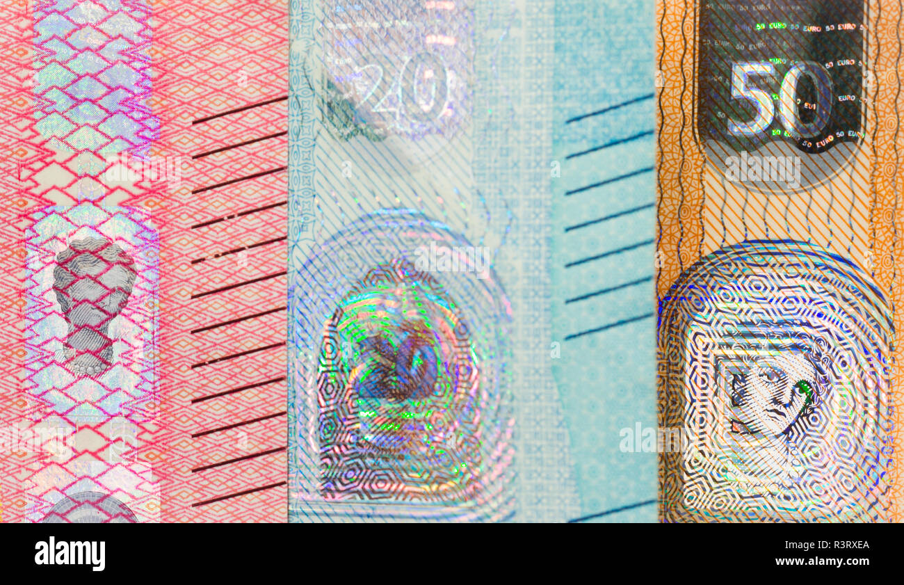 Close-up of the Goddess Europe on the hologram a new twenty euro banknote. With others banknotes out of focus. - Stock Image