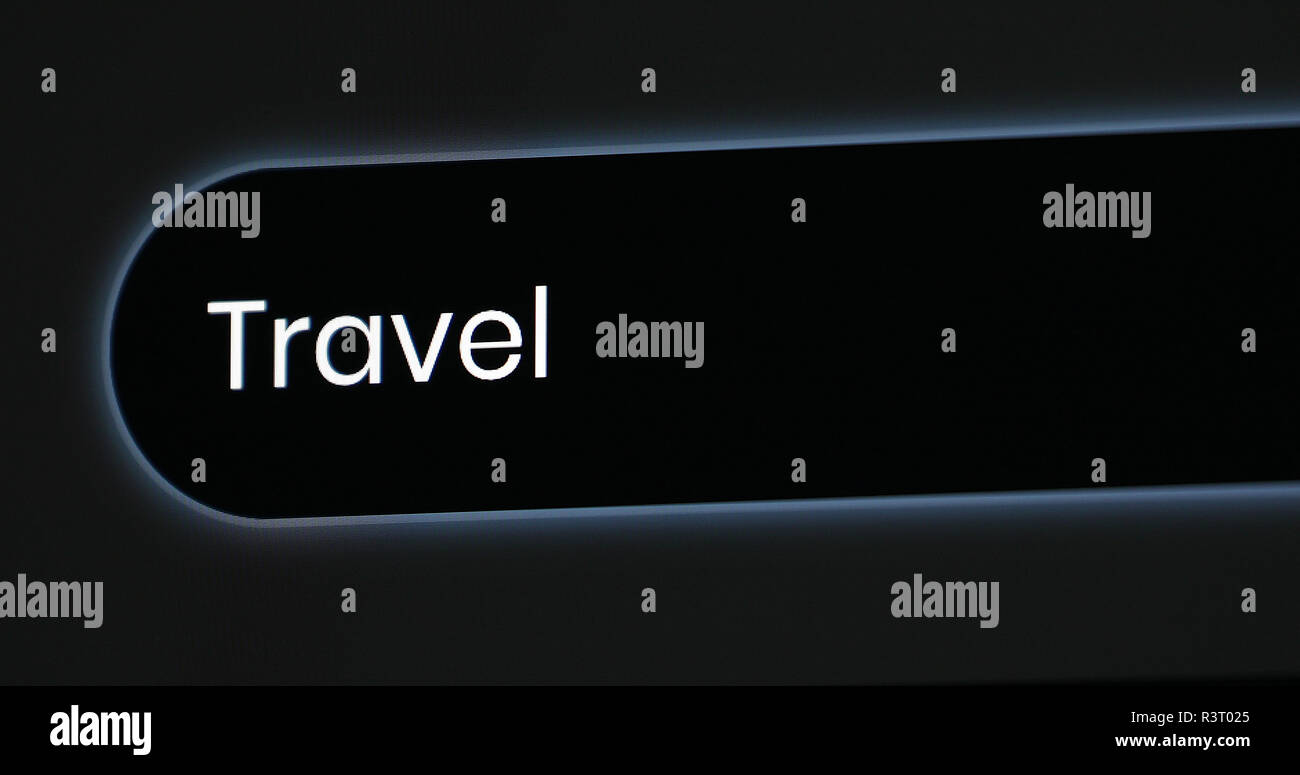 Word Travel Written In Search Bar. Close Up View Of A Computer Monitor Screen Stock Photo