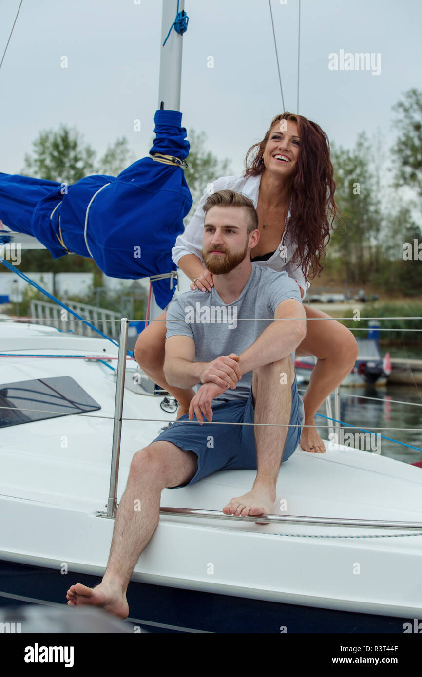 Couple relaxing together on a sailing boat - Stock Image