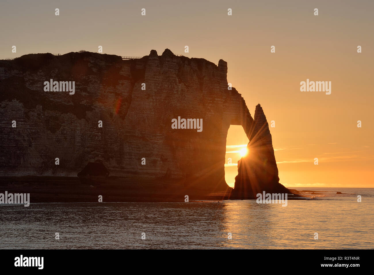France, Normandy, Cote d'Albatre, rock coast of Etretat by sunset - Stock Image