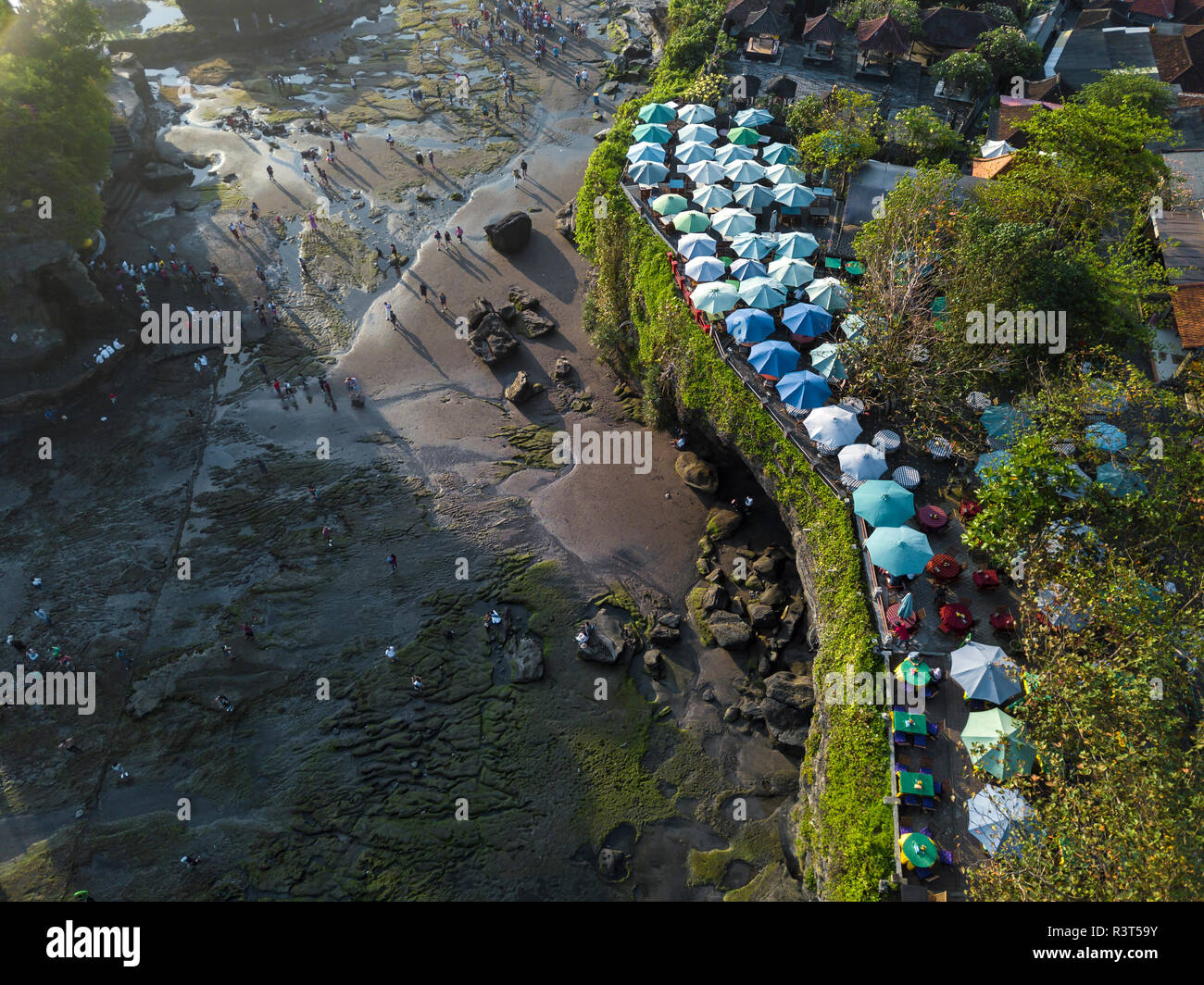 Indonesia, Bali, Aerial view of sunshades at Tanah Lot-temple - Stock Image