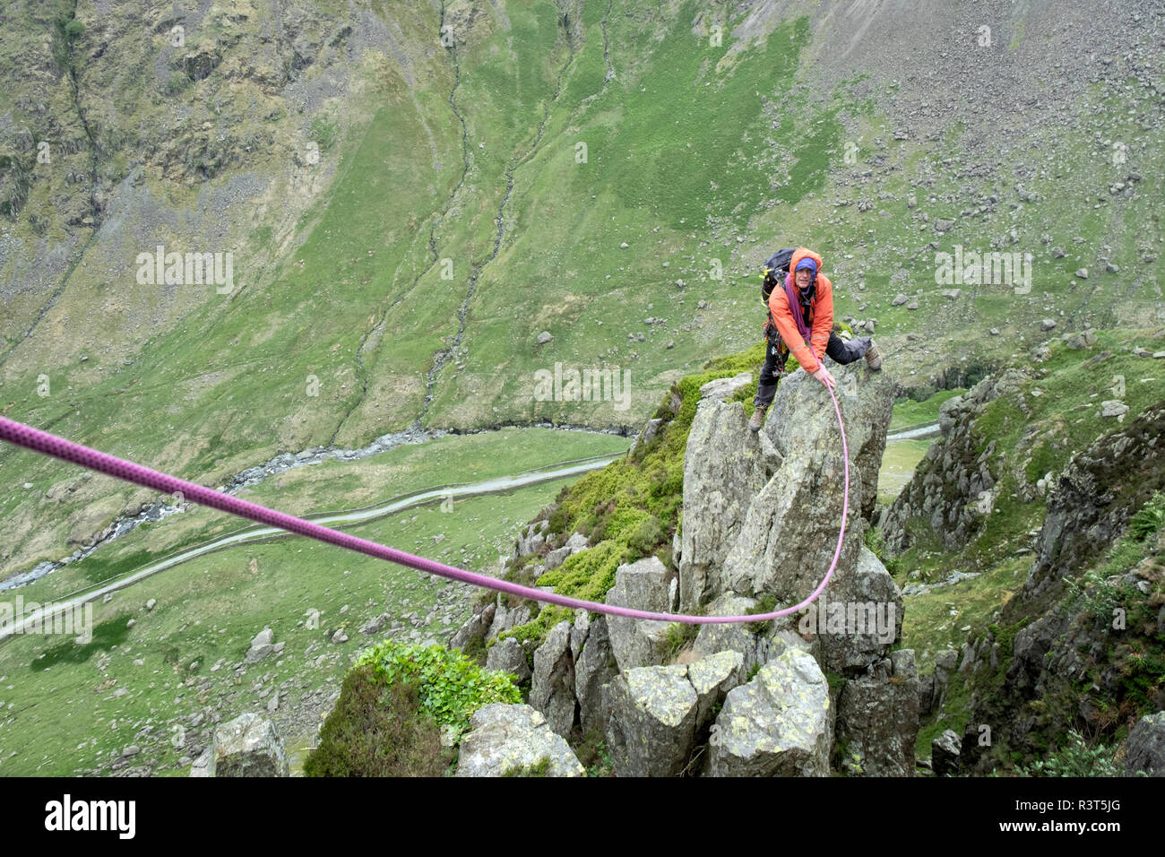 UK, Lake District, Longsleddale valley, Buckbarrow Crag, man climbing on rock - Stock Image