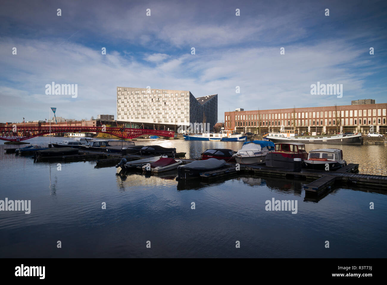 Netherlands, Amsterdam. Eastern Docklands, Spoorweg-basin with The Whale Building and renovated docklands area - Stock Image