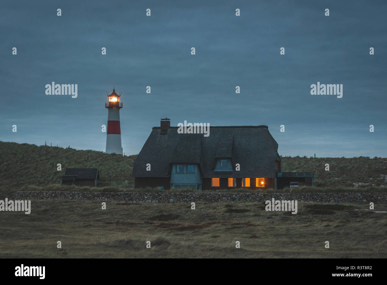 Germany, Schleswig-Holstein, Sylt, Ellenbogen, lighthouse List Ost in the evening - Stock Image
