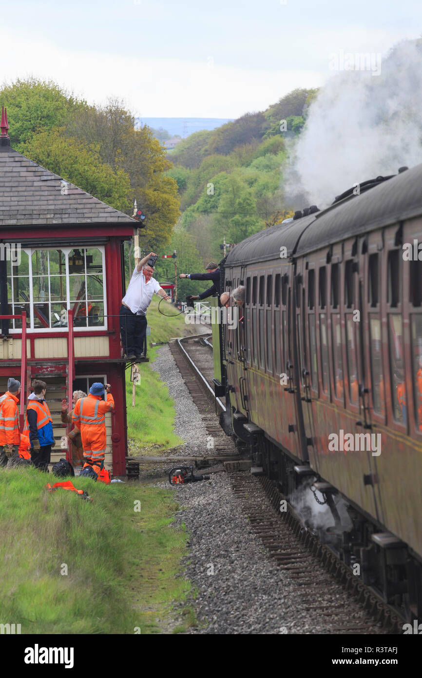 England, West Yorkshire. Keighley and Worth Valley Railway, steam trains, 5-miles up Worth Valley to Haworth and Oxenhope. Handoff. - Stock Image