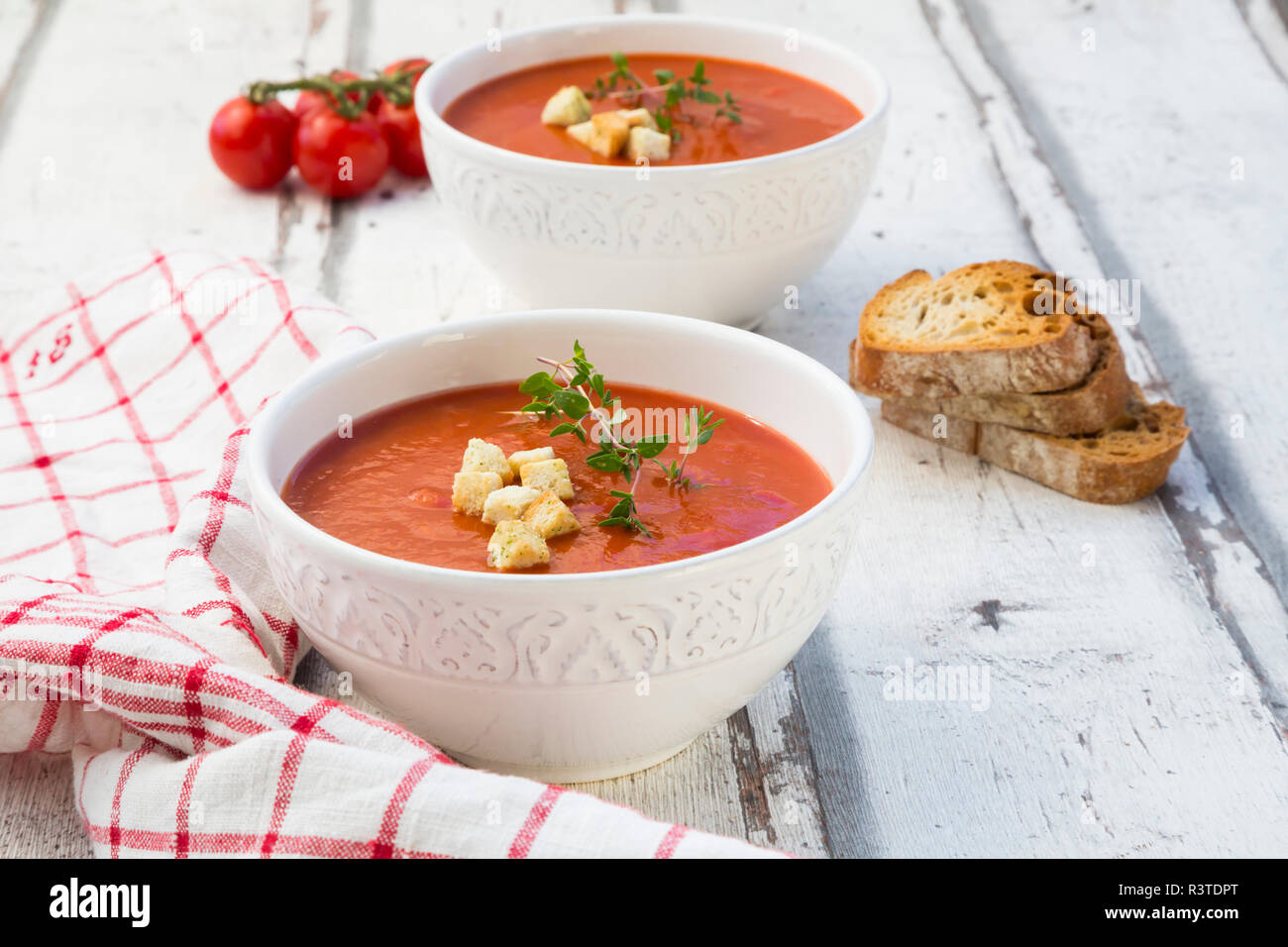 Mediterran tomato soup with roasted bread, croutons and thyme - Stock Image