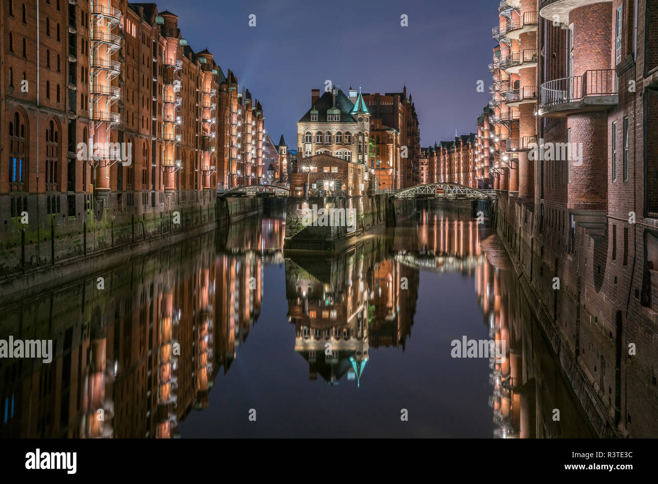 Germany, Hamburg, Speicherstadt, lighted old buildings with Elbe Philharmonic Hall in the background Stock Photo