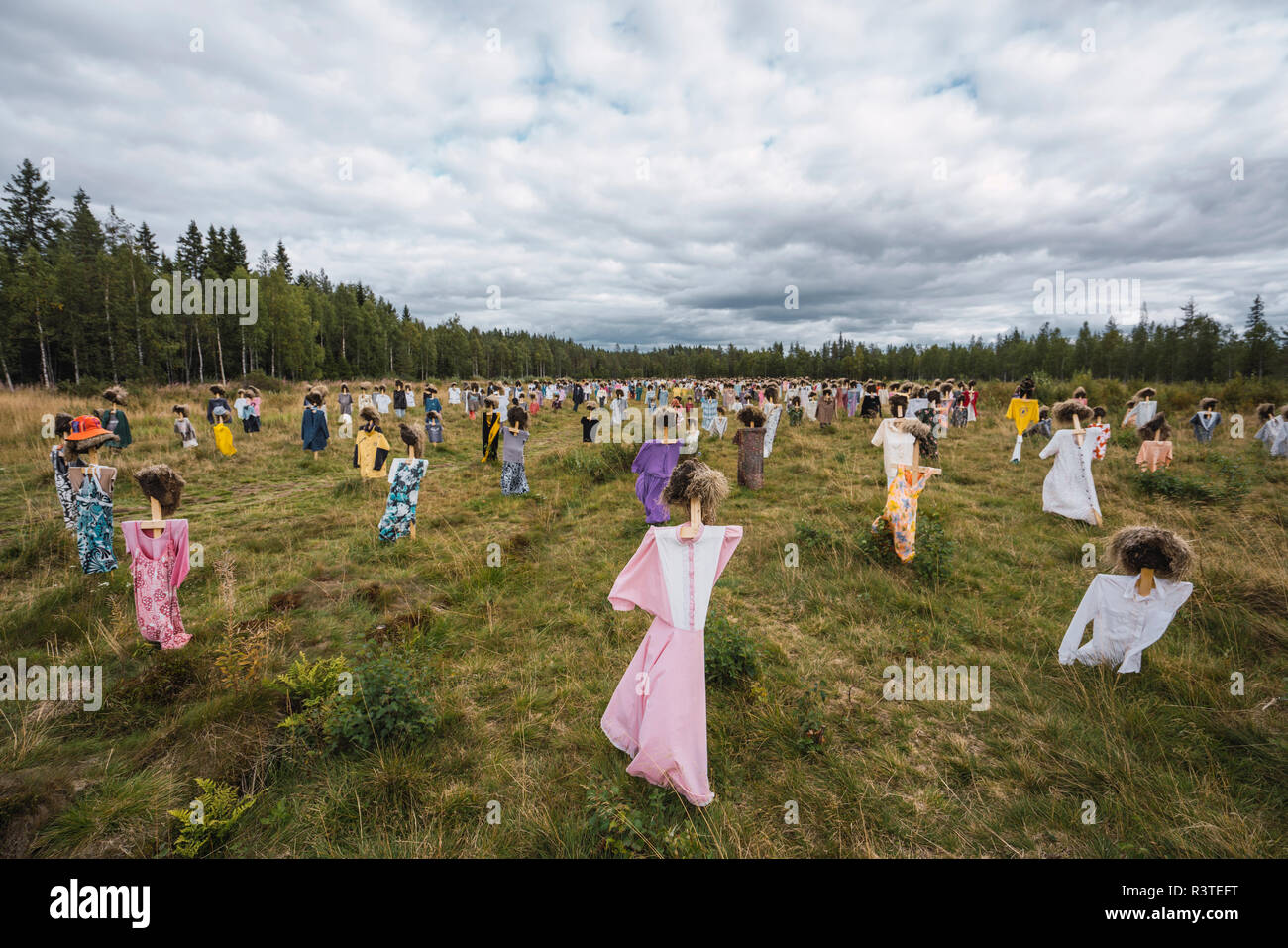 Finland,  Suomussalmi, The Silent People, art project with crowd of scare crows - Stock Image