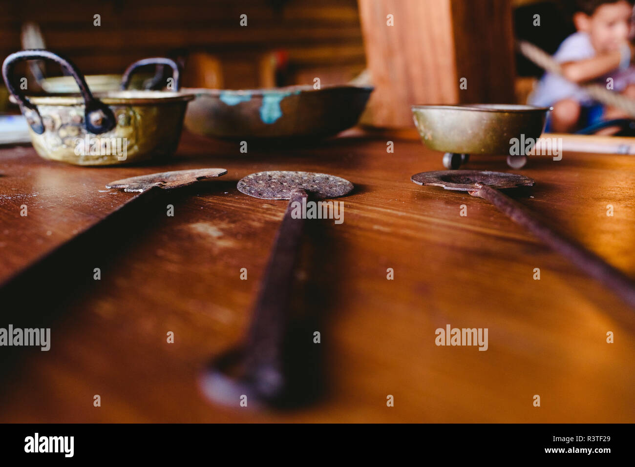 Old kitchen utensils on an old wooden table. - Stock Image