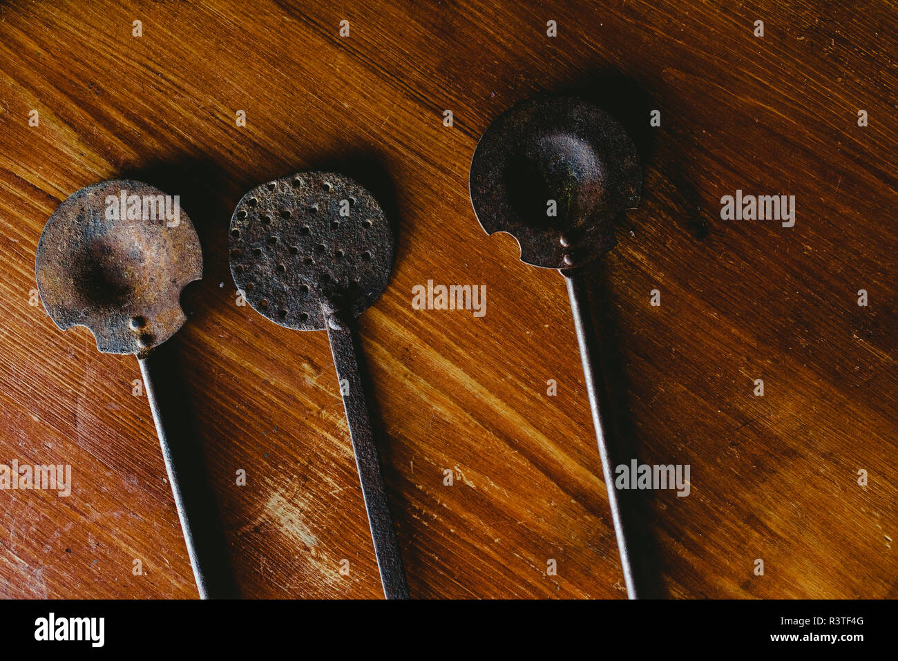 Old kitchen utensils on an old wooden table. Stock Photo
