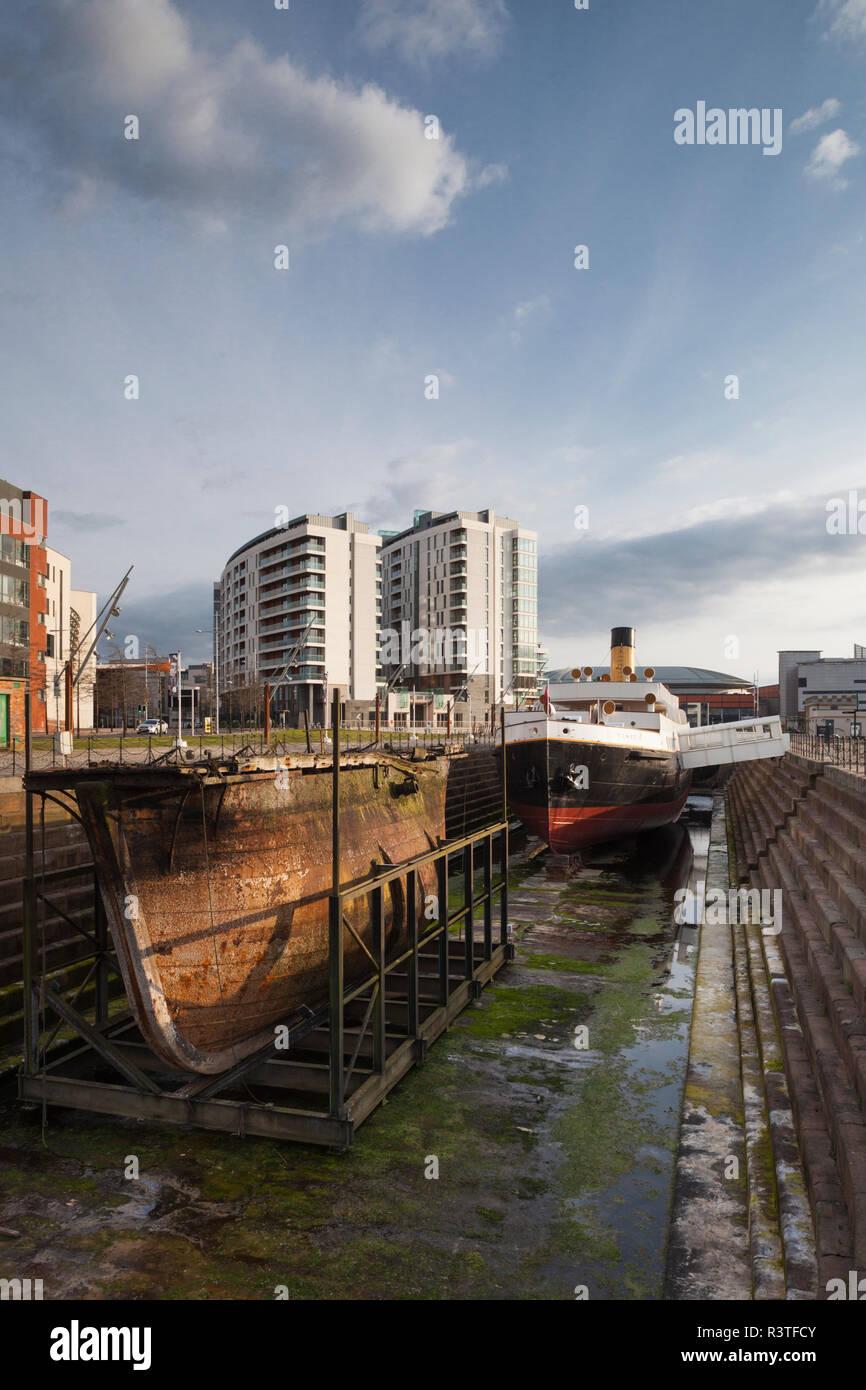 UK, Northern Ireland, Belfast Docklands, Titanic Belfast Museum, and SS Normandie, ship tender - Stock Image